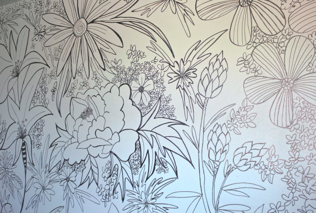 Diy on a budget hand drawn floral wall mural for Creating a mural